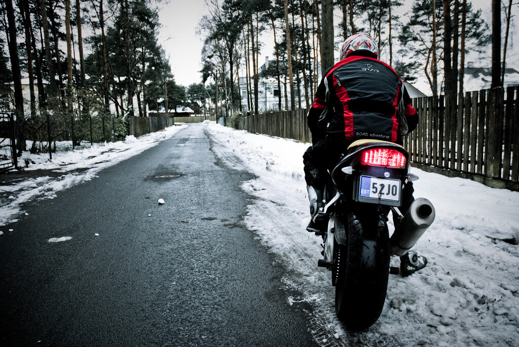 Riding a motorcycle on snow.
